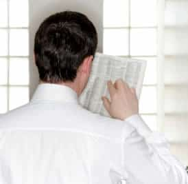 man looking into yellow pages
